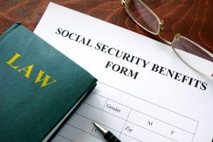 Social security benefits form on a wooden table.